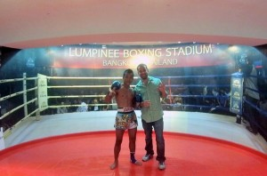 Me posing with a pro Muay Thai Fighter at Lumpinee Stadium in BKK... I could probably take him.