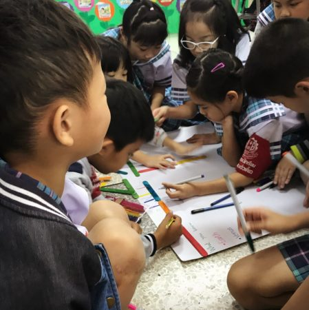 Thai children working on project. teach english overseas