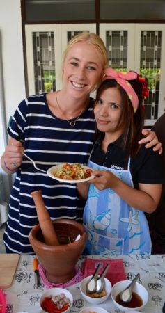 A teacher and a Thai woman make papaya salad. teaching english abroad