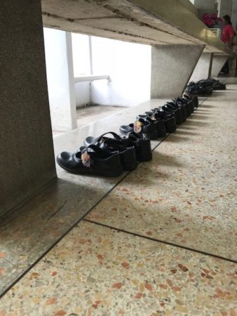 student shoes lined up outside classroom. teach english overseas