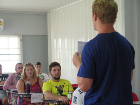 A participant practices teaching in his in-class TESOL course