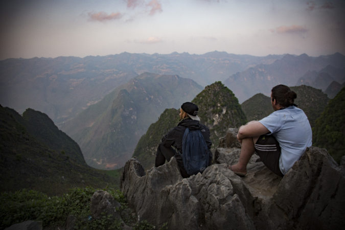 Two men look off over the mountains. Teach in Vietnam