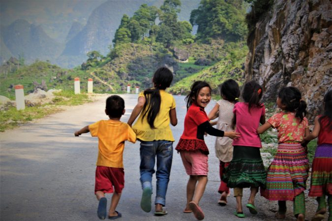 Vietnamese children run from the camera. Teach in Vietnam