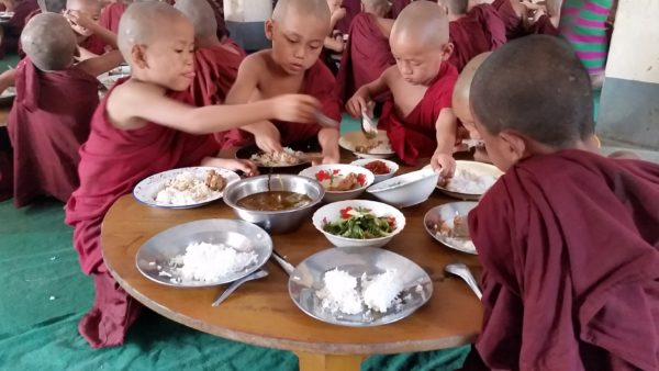 Boy monks eat lunch in Yangon. Come teach monks in Myanmar!