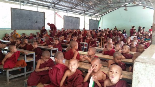 A group of boy monks wait for lunch. Come teach monks in Myanmar!