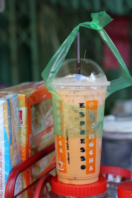 Plastic cup with plastic lid and plastic straw in a plastic bag in Thailand