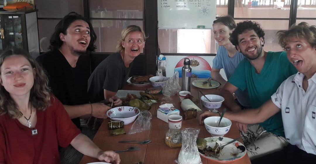 The volunteers enjoying some bonding time at dinner after a night out In Thailand