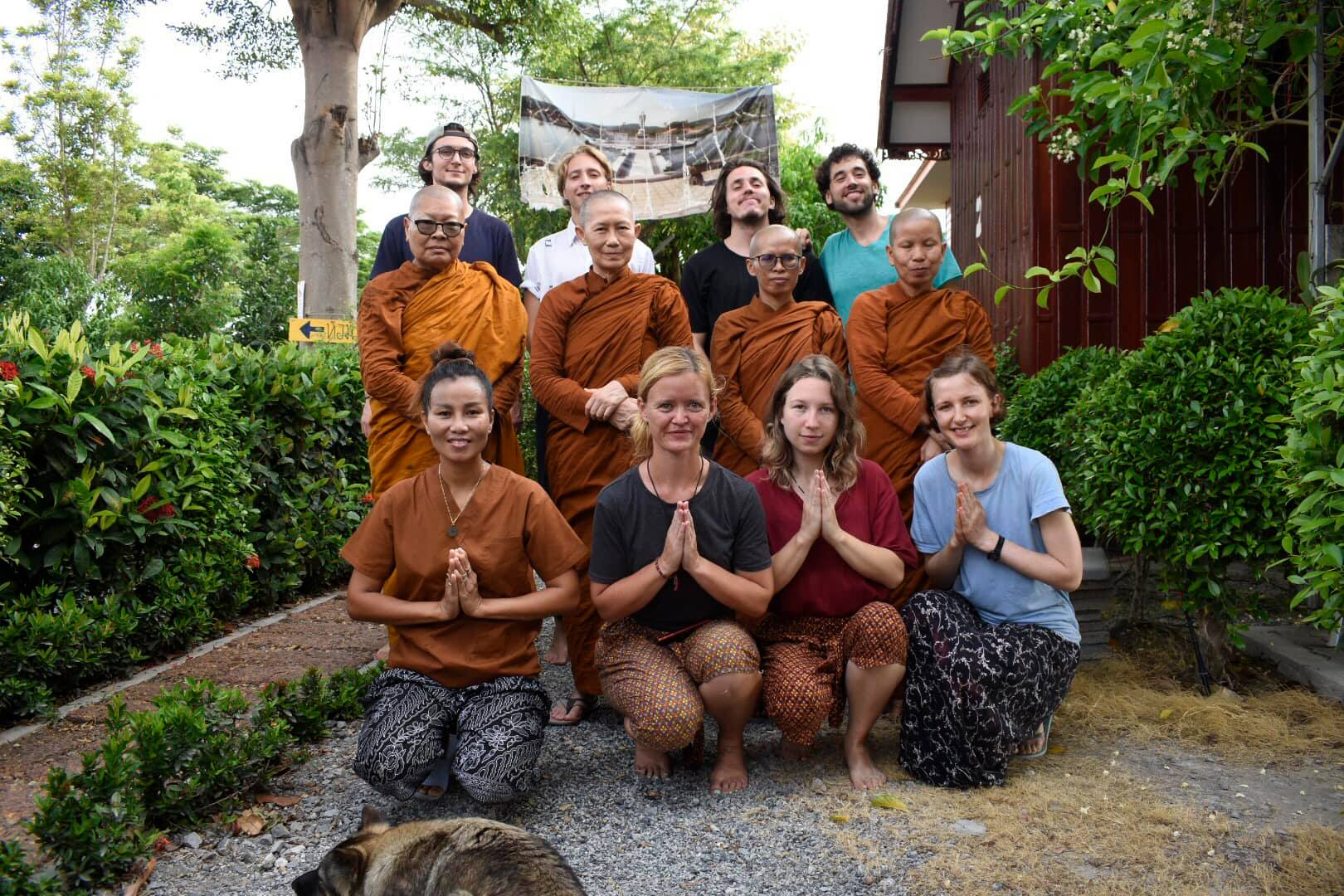 The volunteers and Bhikkhuni pose outside of the meditation center in Thailand