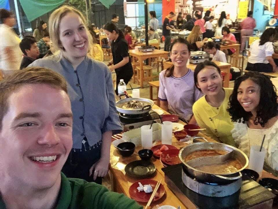 Hayley and her international friends enjoyng a meal together in Thailand